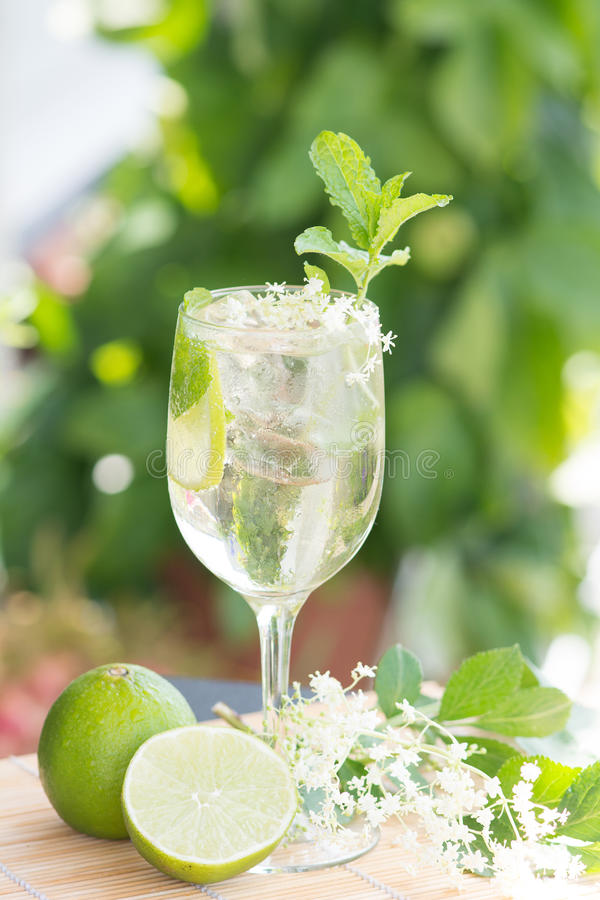 Hugo Champagne drink with elderflower syrup, mint and lime. Summer drink Hugo Champagne drink with elderflower syrup, mint and lime stock photography