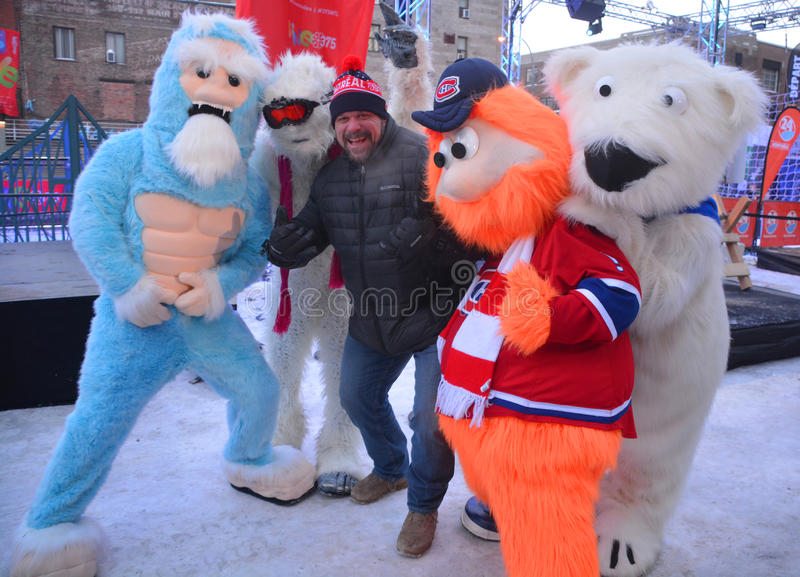 Hugo Girard with Mascot Youppi!, Yeti and Polar bear royalty free stock image