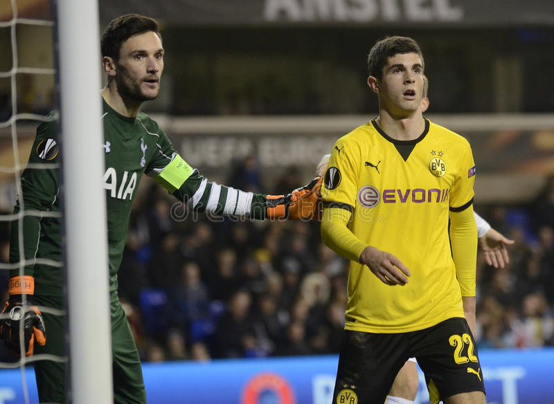 Hugo Lloris and Christian Pulisic. Football players pictured during UEFA Europa League round of 16 game between Tottenham Hotspur and Borussia Dortmund on March royalty free stock photo