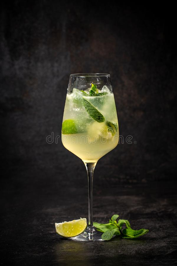 Hugo prosecco with ice and lime royalty free stock image