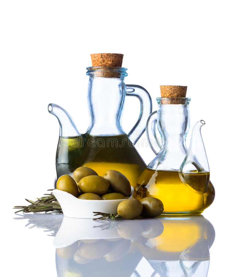 Huile et olives d'olive sur le fond blanc photographie stock libre de droits