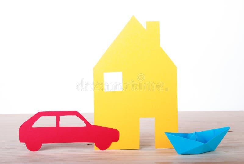 Huis, Boot en Auto stock foto's