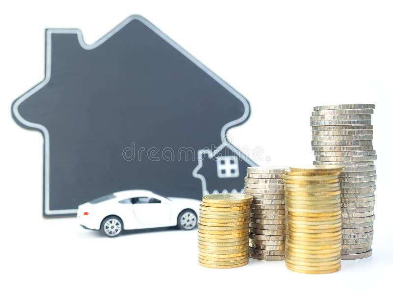 Huis en auto met muntstukken royalty-vrije stock fotografie