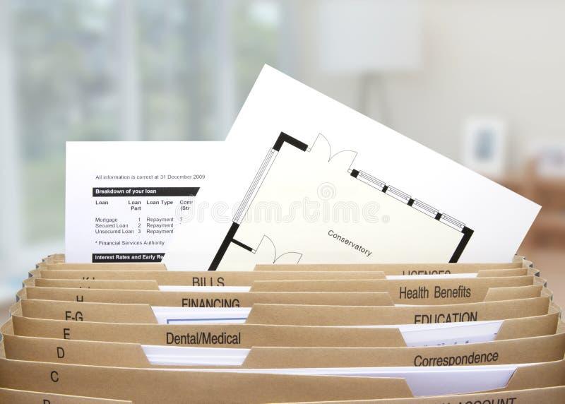 Huis het indienen verdelers die hypotheekverklaringen tonen stock afbeeldingen