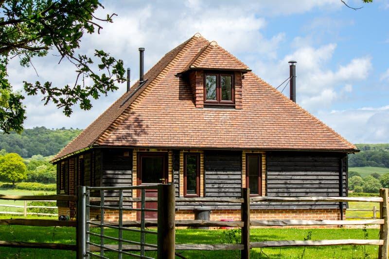 Huis in het land stock foto's