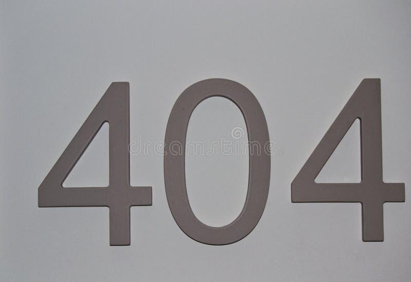 Huis of hotelruimteaantallen op duidelijke grijze oppervlakte, voor grafisch concept royalty-vrije stock fotografie