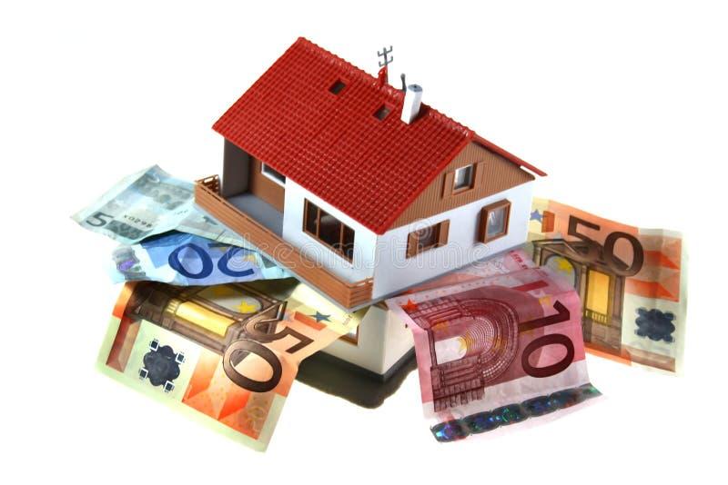 Huis met geld stock fotografie