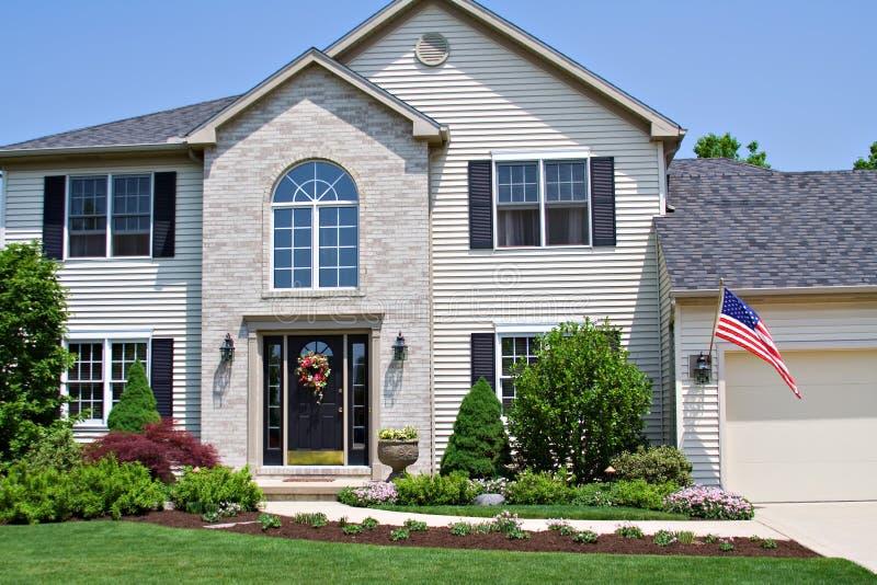 Huis met Vlag stock afbeeldingen