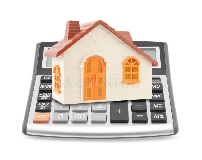 Huis op calculator stock afbeelding