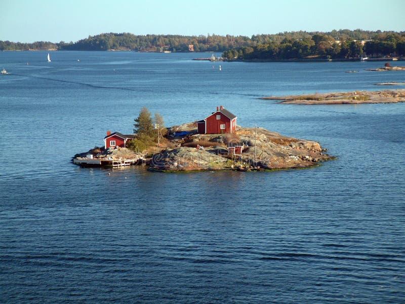Huis op eiland royalty-vrije stock afbeelding