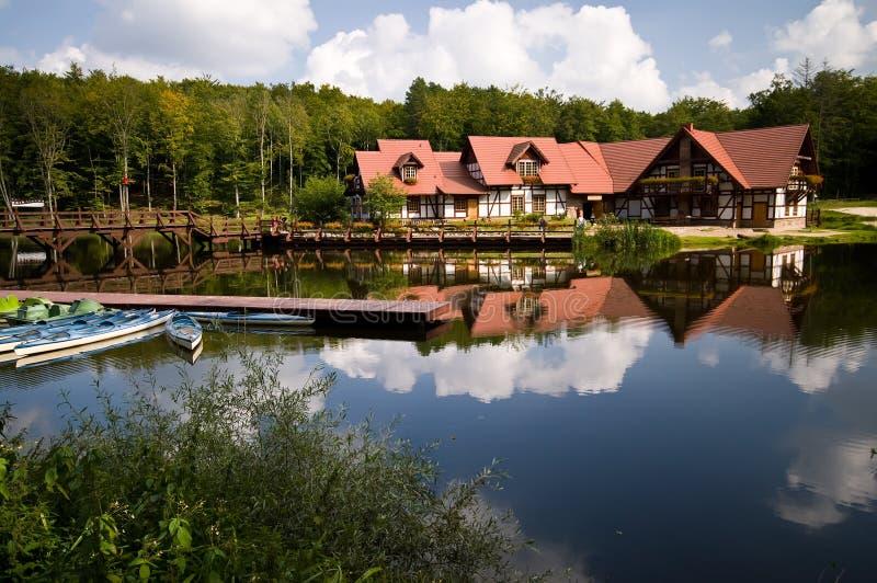 Huis op water stock fotografie