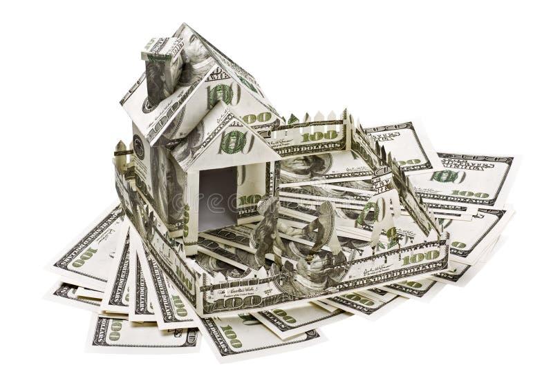 Huis van geld wordt gemaakt dat stock foto's