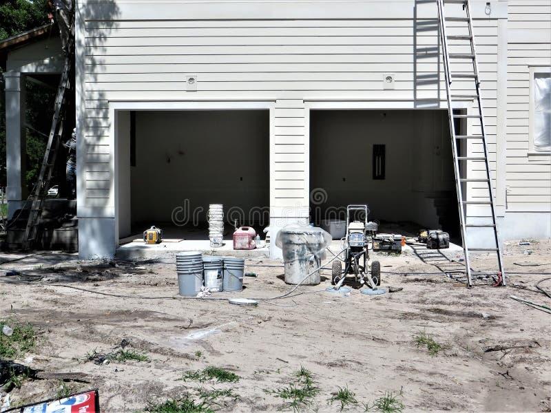 Huisbouwwerf, Tamper stock afbeelding