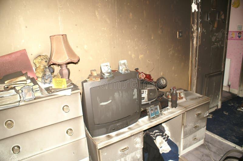Huisbrand, brand beschadigd huis, stock fotografie