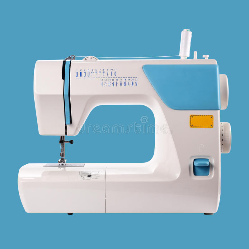 Huishoudapparaten - naaien-Machine blauwe achtergrond stock fotografie