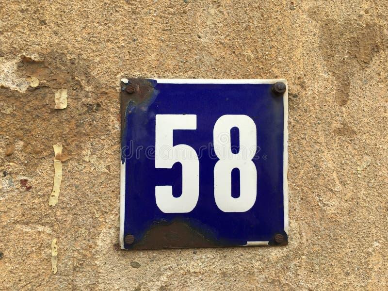 Huisnummer 58 stock afbeelding