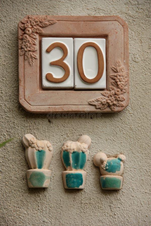 Huisnummer 30 stock foto