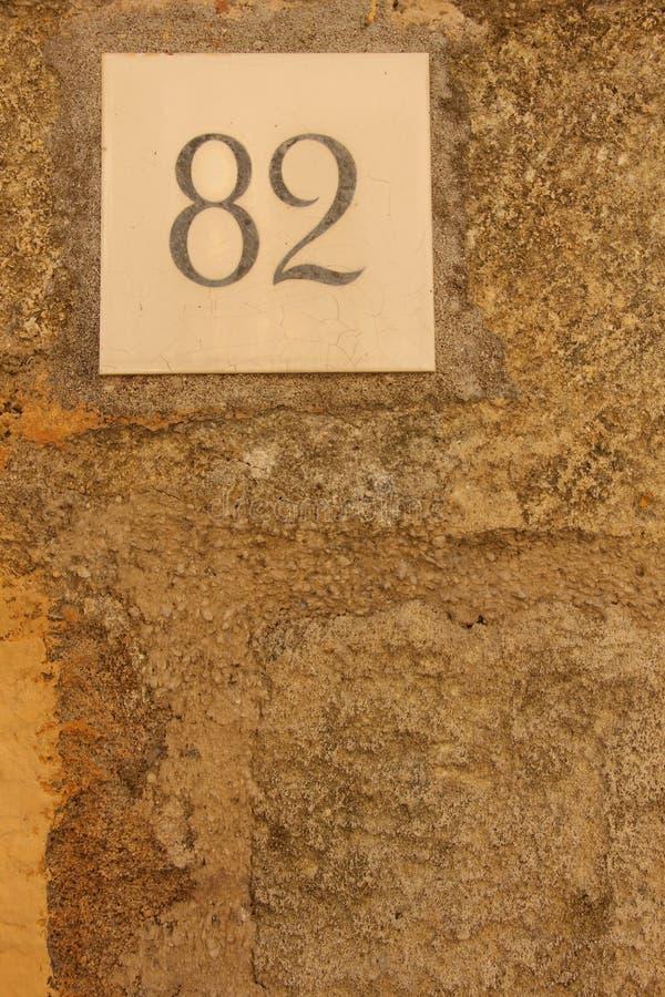 Huisnummer 82 stock foto