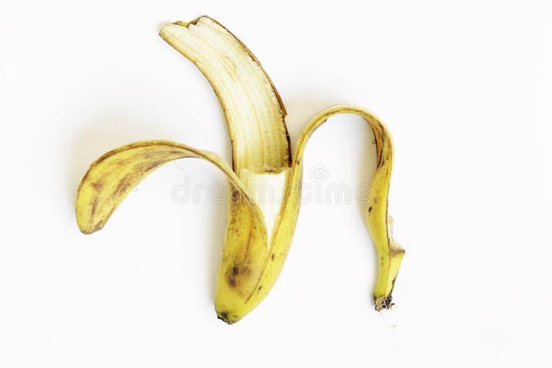 Huisvuil gele en zwarte rijpe bananeschil royalty-vrije stock foto's