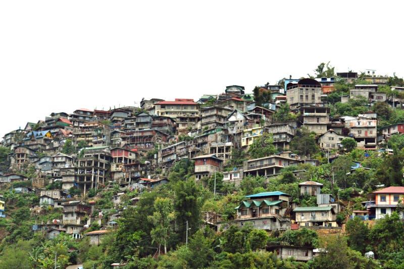 Huizen in de bergen: Baguiostad, Filippijnen stock afbeeldingen