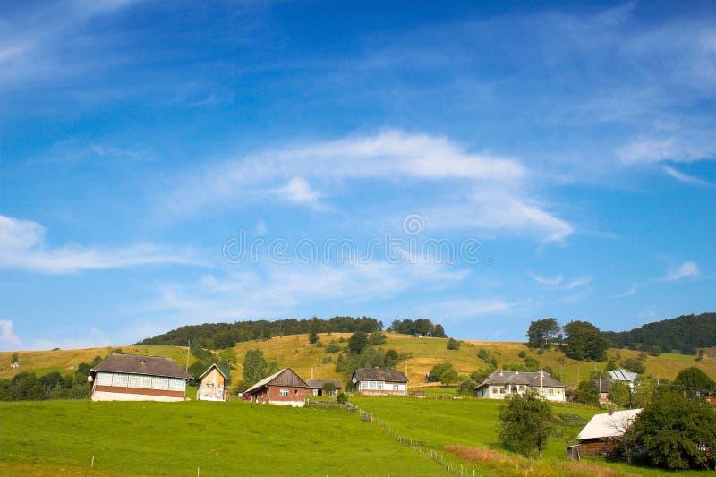 Huizen op de heuvel stock foto's