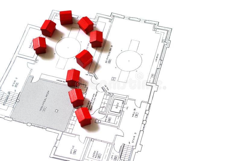 Huizen op een plan en een vraag stock afbeelding