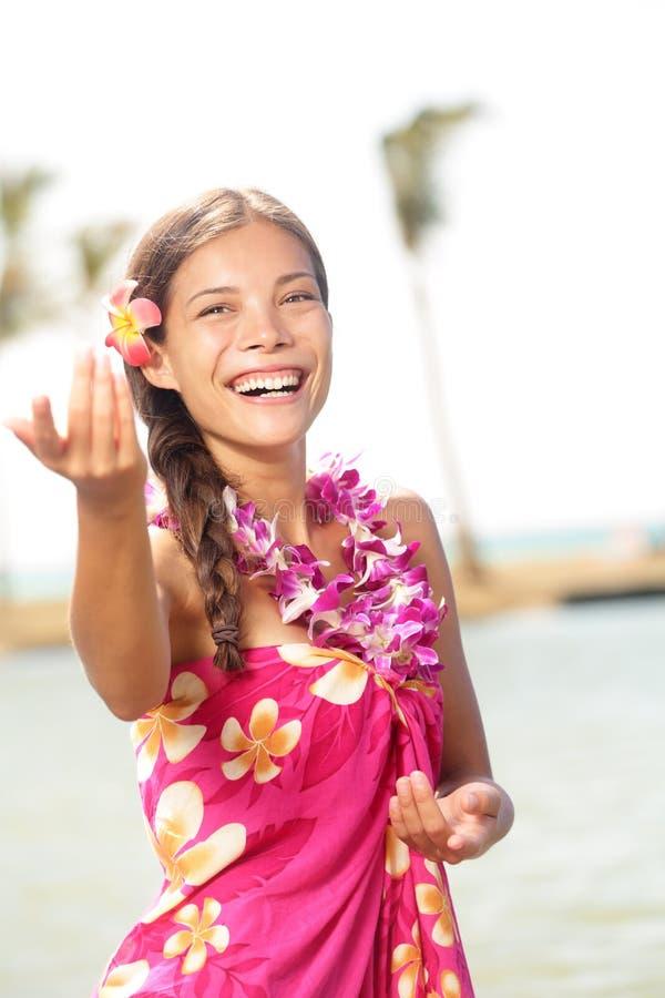 Hula dancer dancing hula dance on hawaii. Hula dancer woman dancing hula dance on Hawaii wearing Hawaiian orchid flower lei smiling happy on beach. Travel royalty free stock image