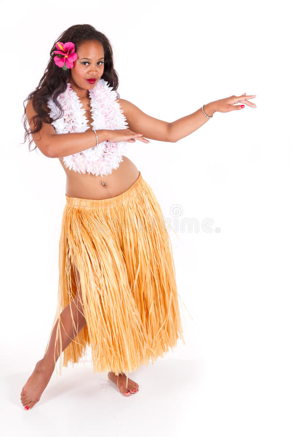 Hula dancer with typical dance move. Beautiful hula dancer showing a typical dance move royalty free stock photo