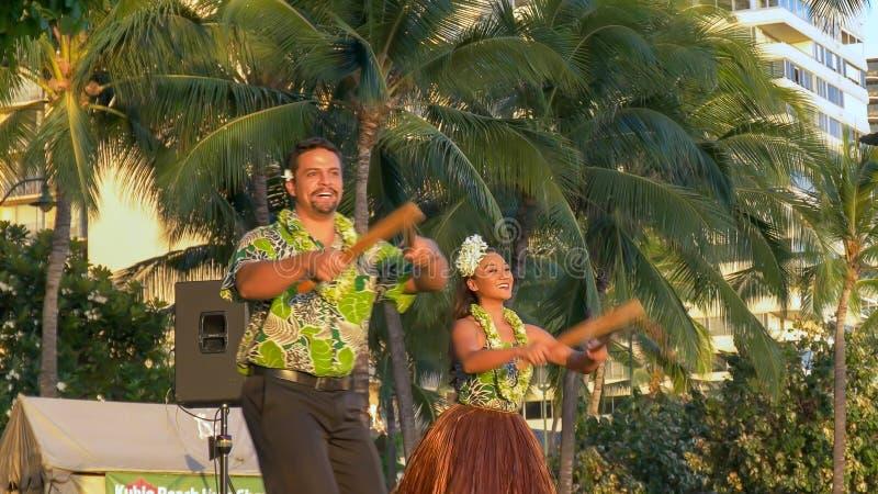 Hula dancers with puili at waikiki in hawaii royalty free stock photo