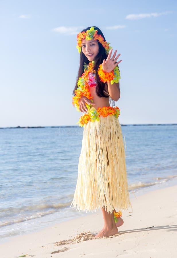 Hula Hawaii dancer dancing on the beach. Hula Hawaii dancer dancing on the sea beach stock images
