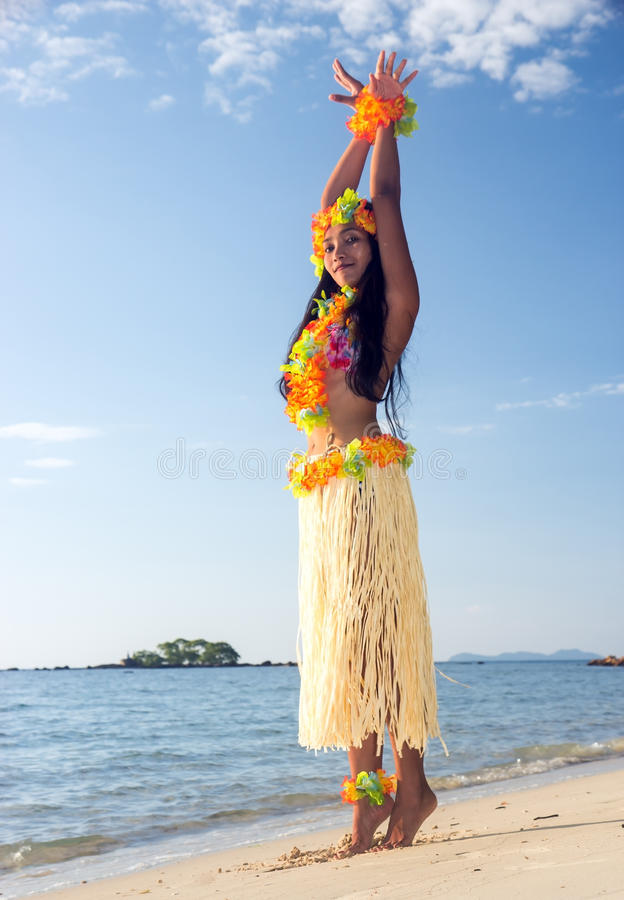 Hula Hawaii dancer. Dancing on the sea beach royalty free stock photos
