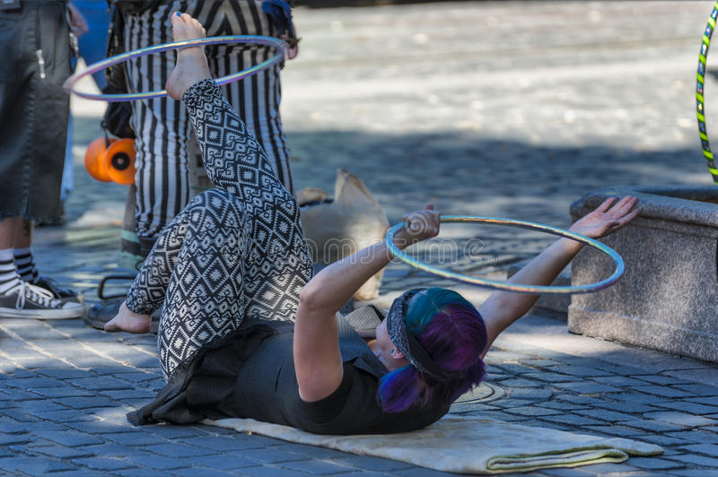 Hula Hoop street entertainer at Ankeny Square, Portland royalty free stock images