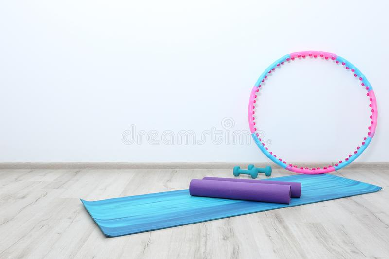 Hula hoop, yoga mats and dumbbells stock photos