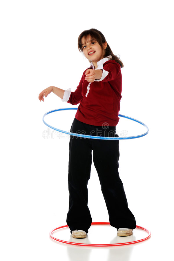 Hula Hooper. An older elementary girl spinning a hoola hoop. Isolated on white stock photos