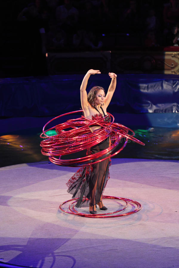 Hula hoops. MOSCOW, RUSSIA - NOVEMBER 27: The presentation of the Golden Buff. The woman turns a lot of hula hoops of the Moscow State Circus on November 27 royalty free stock photo