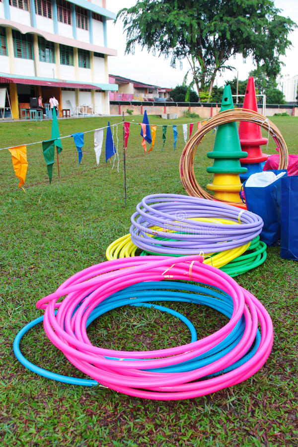 Hula hoops and cones at school playground. Kid playground items such hula hoops and cones on school playground stock photos