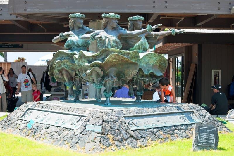 Hula Kahiko women dancers statue in Kona at Keahole international airport stock image