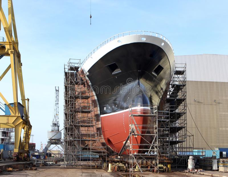 Hull of big ship under construction at shipyard.The part of the new ship`s building in the shipyard. stock photography