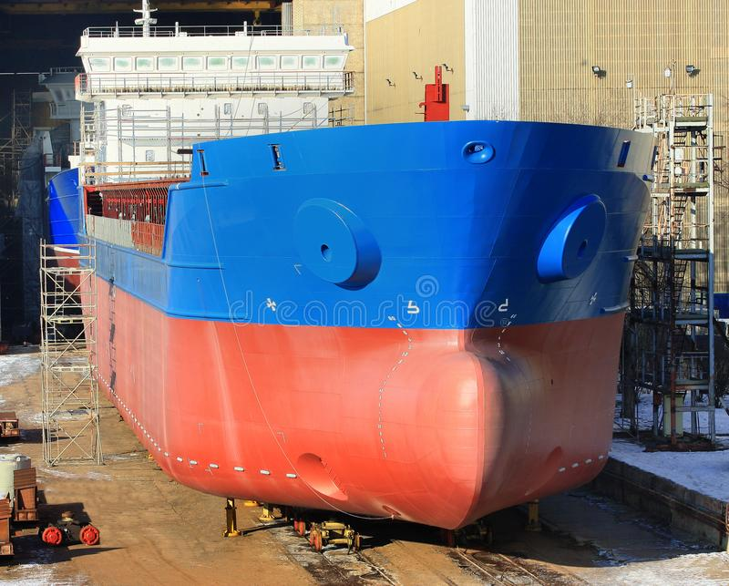 Hull of big ship under construction at shipyard.The part of the new ship`s building in the shipyard. stock photo