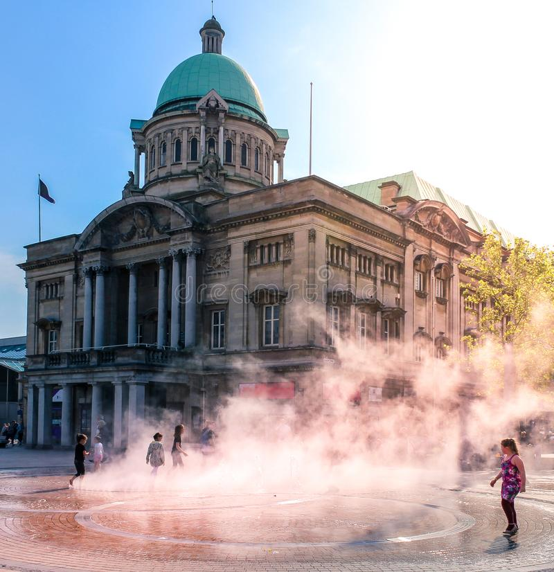 Hull City Hall and steam fountain. Enlighted by sunset royalty free stock photography