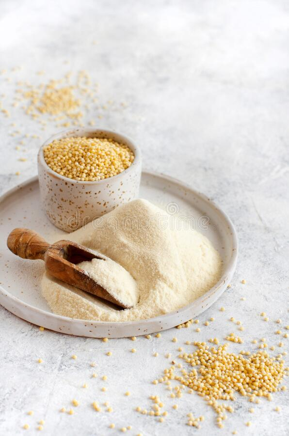 Hulled millet flour and grain. Close up royalty free stock photography