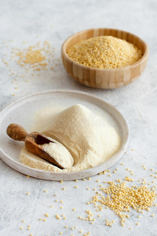 Hulled millet flour and grain. Close up stock photo