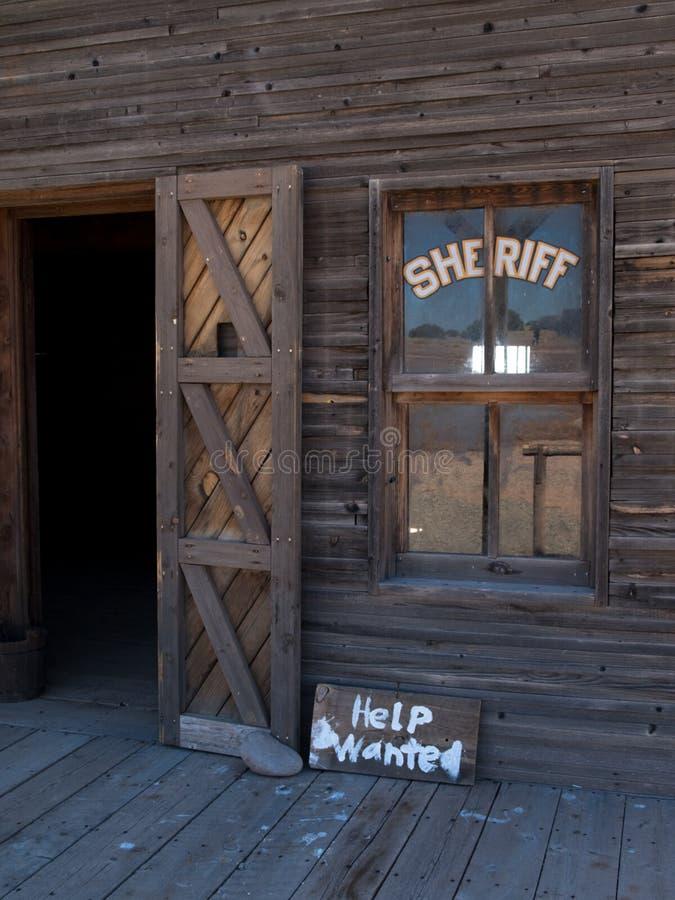 Hulp die op het Kantoor van de Sheriff wordt gewild stock afbeeldingen