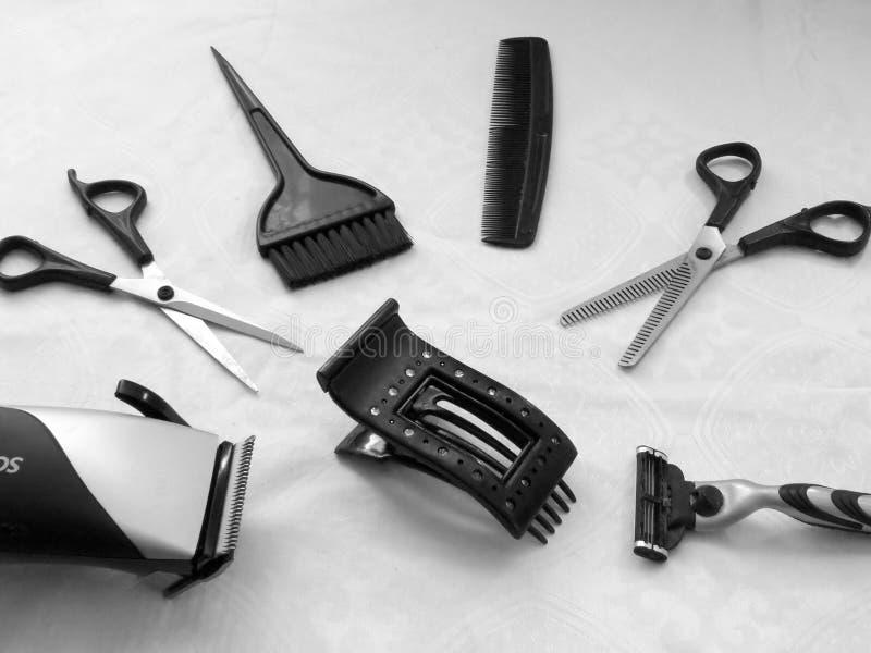 Hulpmiddelen noodzakelijk voor de kapper stock afbeelding