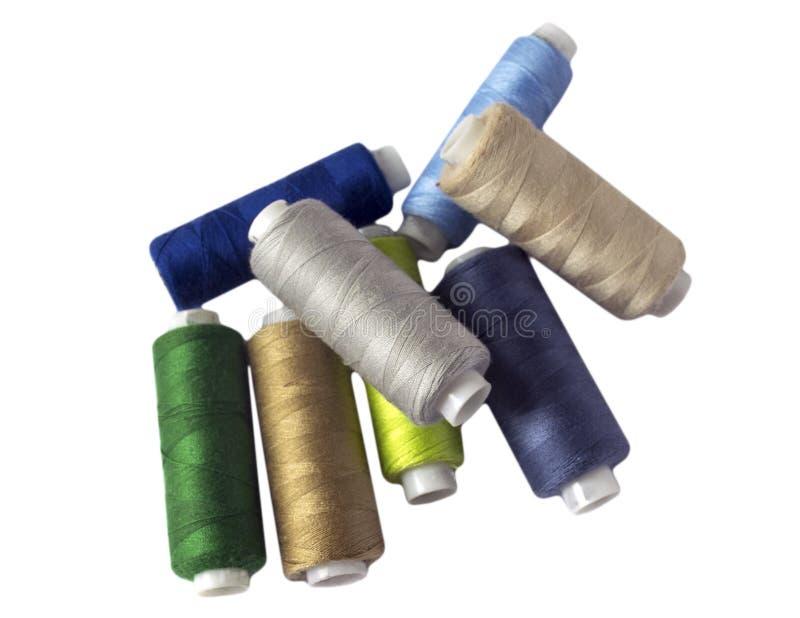 Hulpmiddelen om te naaien en handwerk hobby Multi-colored naaiende draad stock foto