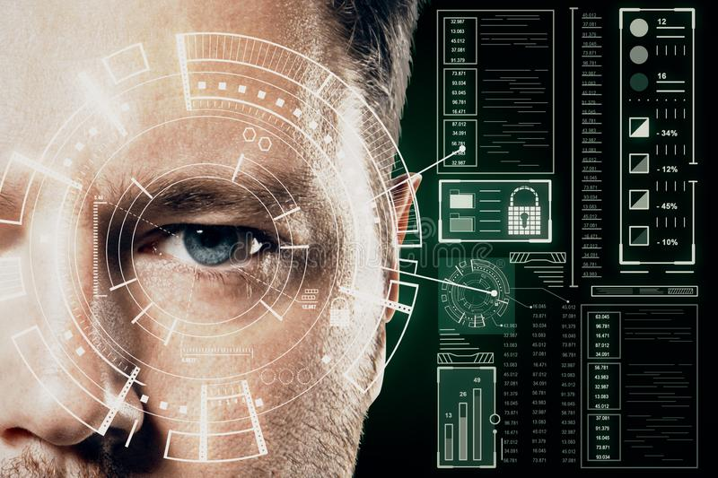 Human being futuristic vision concept with blue eye man and cyberspace screen stock images