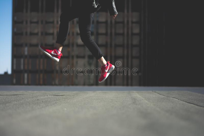Human In Black Track Pants With Red Nike Sneakers Jumping Free Public Domain Cc0 Image