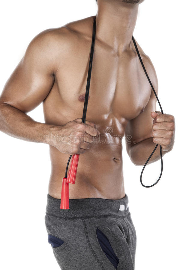 Human body and jump rope. Muscular man with red jump rope, isolated on white background royalty free stock photos