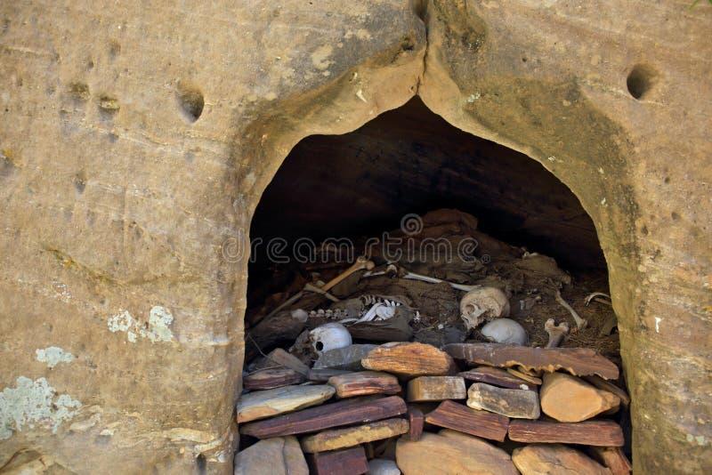 Human bones and skulls near rock-hewn church. In Ethiopia stock photography