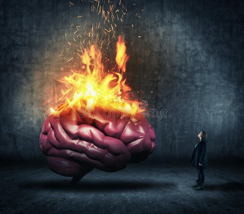 Human brain on fire. Woman looks up to a human brain on fire stock photos